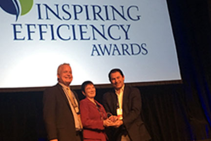Robin & Gary receiving Inspiring Efficiency Education Award